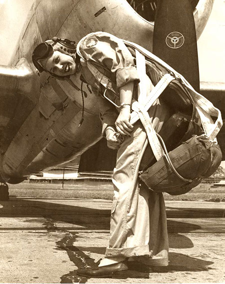 WASP Deanie Bishop Parrish strapping on her parachute.